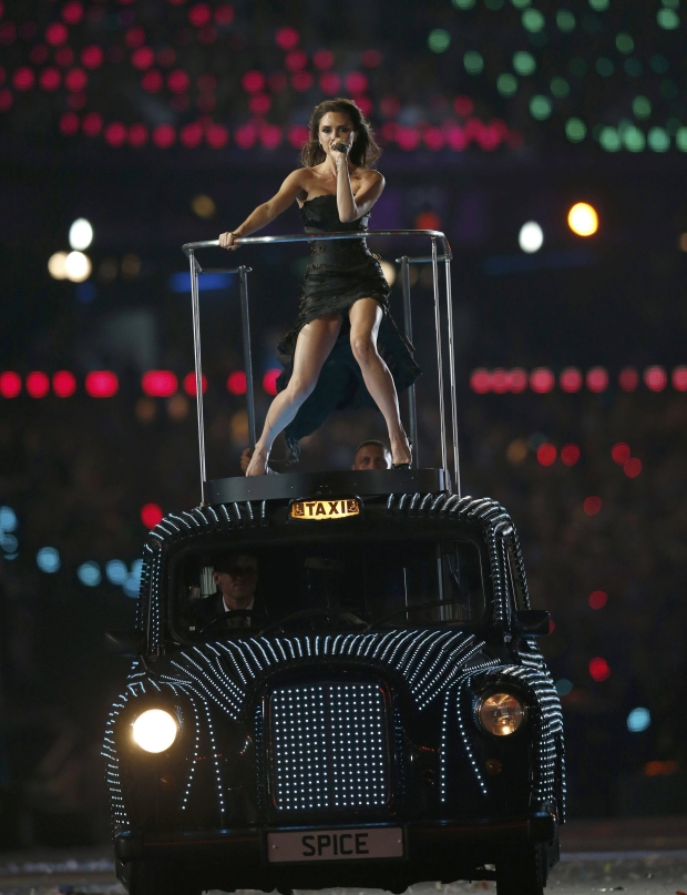 Victoria Beckham performs with The Spice Girls during the closing ceremony of the London 2012 Olympic Games at the Olympic Stadium, August 12, 2012.               REUTERS/Suzanne Plunkett (BRITAIN  - Tags: SPORT OLYMPICS ENTERTAINMENT)