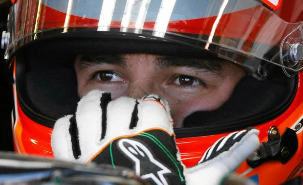 Force India Formula One driver Sergio Perez of Mexico adjusts his helmet during the first practice session of the Australian F1 Grand Prix at the Albert Park circuit in Melbourne March 14, 2014. REUTERS/Brandon Malone (AUSTRALIA  - Tags: SPORT MOTORSPORT F1)   SLOWA KLUCZOWE: :rel:d:bm:SR1EA3E0AVF40