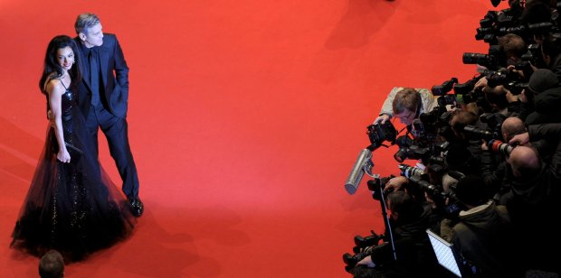 Cast member George Clooney and his wife Amal arrive on the red carpet for the screening of the movie 'Hail, Caesar!', during the opening gala of the 66th Berlinale International Film Festival, in Berlin, Germany February 11, 2016.       REUTERS/Stefanie Loos