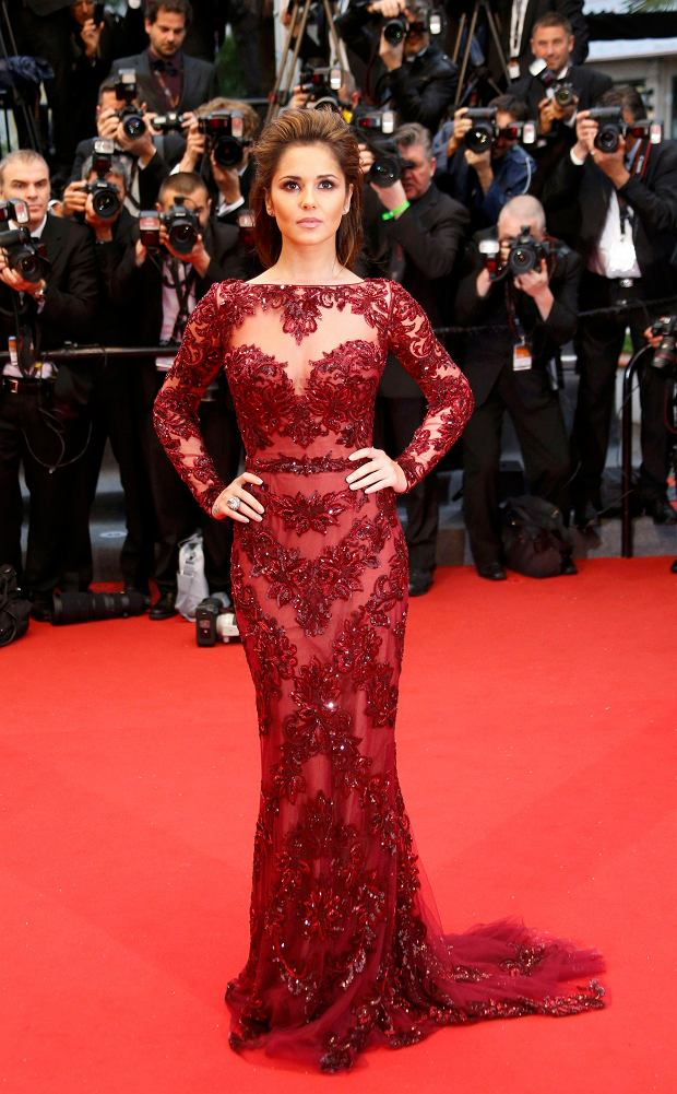 Singer Cheryl Cole poses on the red carpet as she arrives for the screening of the film 'Jimmy P.' (Psychotherapy of a Plains Indian) in competition at the 66th Cannes Film Festival in Cannes May 18, 2013.                       REUTERS/Yves Herman (FRANCE  - Tags: ENTERTAINMENT)