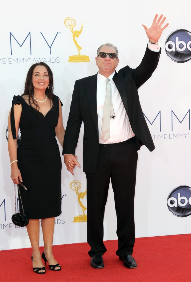 Actor Ed O?Neil, right and his wife Catherine Rusoff arrive at the 64th Primetime Emmy Awards at the Nokia Theatre on Sunday, Sept. 23, 2012, in Los Angeles. (Photo by Matt Sayles/Invision/AP)