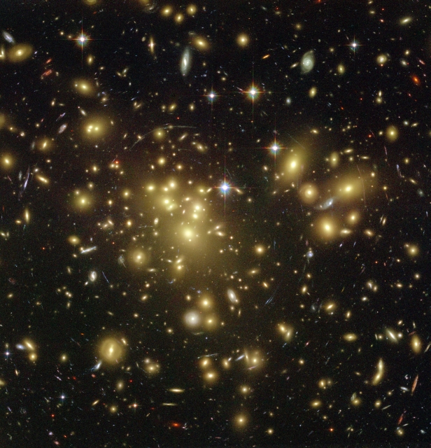 Caption: Researchers have analyzed measurements of the light from galaxies in approximately 8,000 galaxy clusters. Galaxy clusters are accumulations of thousands of galaxies (every light in the image is a galaxy), which are held together by their own gravity. This gravity affects the light that is sent out into space from the galaxies.Credit: Hubble Space Telescope