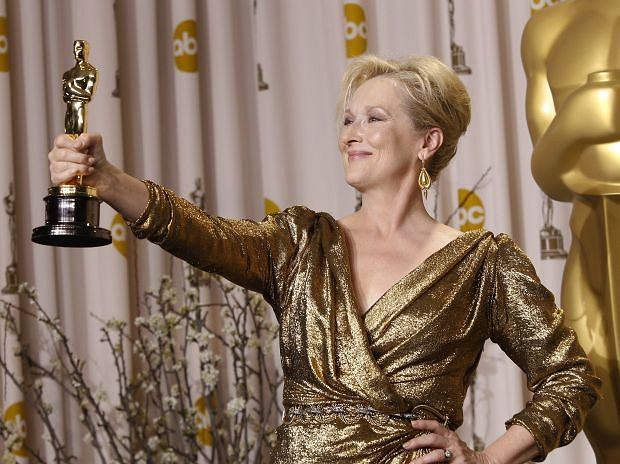 Meryl Steep poses with her award for best actress for