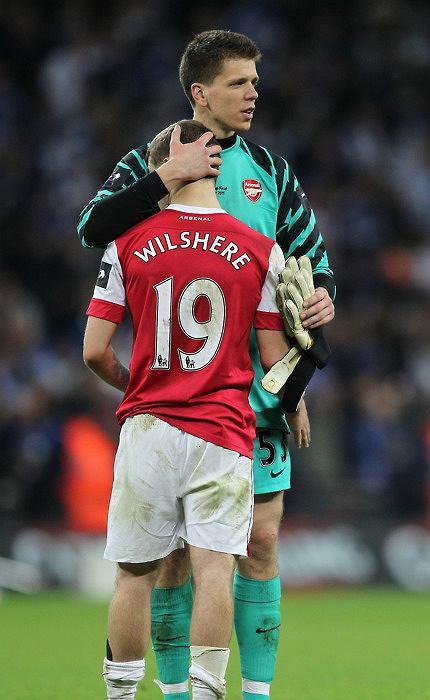 Soccer - Carling Cup - Final - Arsenal v Birmingham City - Wembley Stadium.Arsenal's goalkeeper Wojciech Szczesny and Jack Wilshere URN:10274628