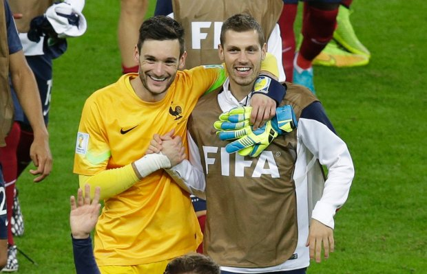 France's goalkeeper Hugo Lloris, left, and  Clement Grenier smile after winning the group E World Cup soccer match between France and Honduras at the Estadio Beira-Rio in Porto Alegre, Brazil, Sunday, June 15, 2014.  (AP Photo/Andrew Medichini)