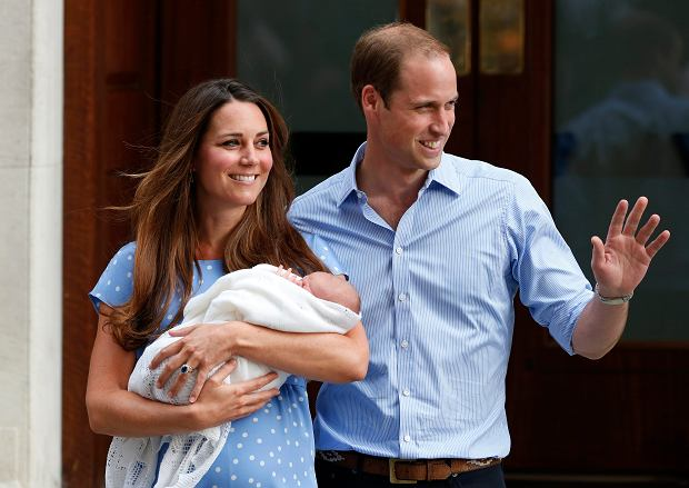 FILE - In this Tuesday, July 23, 2013 file photo, Britain's Prince William and Kate, Duchess of Cambridge hold the Prince of Cambridge,  as they pose for photographers outside St. Mary's Hospital exclusive Lindo Wing in London where the Duchess gave birth on Monday July 22. Royal officials say Britain's new prince has been named George Alexander Louis. Palace officials said Wednesday, July 24, 2013, that the 2-day-old baby and third-in-line to the throne will be known as His Royal Highness Prince George of Cambridge.  (AP Photo/Lefteris Pitarakis, File)