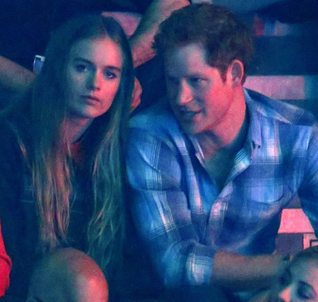 Britain's Prince Harry (R) and Cressida Bonas (2nd R) watch the WE Day UK event at Wembley Arena in London March 7, 2014.  The inaugural WE Day UK event is run by the charity Free the Children to inspire young people to take action on global issues in a voluntary capacity. REUTERS/Luke MacGregor  (BRITAIN - Tags: ENTERTAINMENT BUSINESS POLITICS EDUCATION SOCIETY ROYALS) FOR EDITORIAL USE ONLY. NOT FOR SALE FOR MARKETING OR ADVERTISING CAMPAIGNS