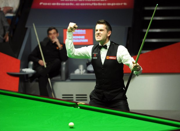 England's Mark Selby  gestures,  after beating England's Ronnie O'Sullivan in the final of the World Snooker Championships, at The Crucible, Sheffield, England,  Monday May 5, 2014. (AP Photo/PA, Anna Gowthorpe)  UNITED KINGDOM OUT: NO SALES: NO ARCHIVE