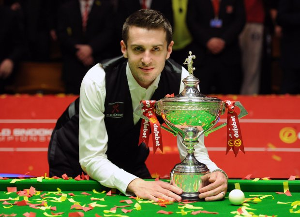 England's Mark Selby poses with the trophy after beating England's Ronnie O'Sullivan in the final of the World Snooker Championships, at The Crucible, Sheffield, England,  Monday May 5, 2014. (AP Photo/PA, Anna Gowthorpe)  UNITED KINGDOM OUT: NO SALES: NO ARCHIVE