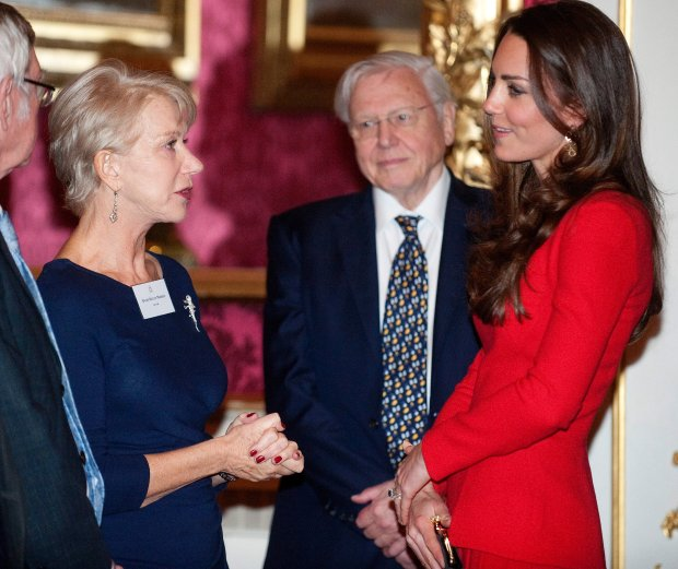 Kate, The Duchess of Cambridge, right, talks to British actress Helen Mirren, left, at a Reception for the Dramatic Arts, at Buckingham Palace, London, Monday, Feb. 17, 2014. (AP Photo/David Crump, Pool)