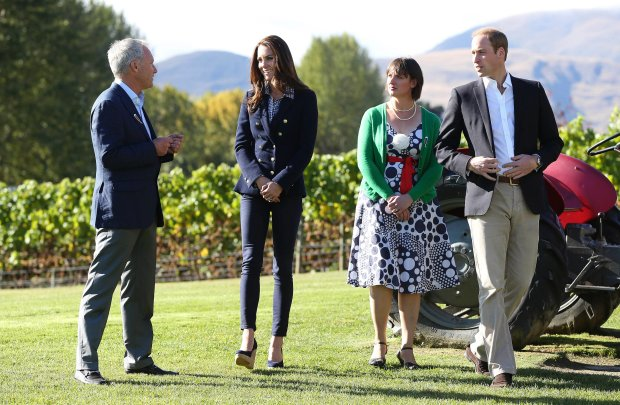 Britain's Prince William, right, and his wife Kate, Duchess of Cambridge, second from left, walk with John Darby, co-owner of Amisfield Winery, left, and Lucie Lawrence, chair of Central Otago Pinot Noir, during a visit to Amsfield Winery in Queenstown, New Zealand, Sunday, April 13, 2014. The royal couple are on an official visit to New Zealand. (AP Photo/Fiona Goodall, Pool)