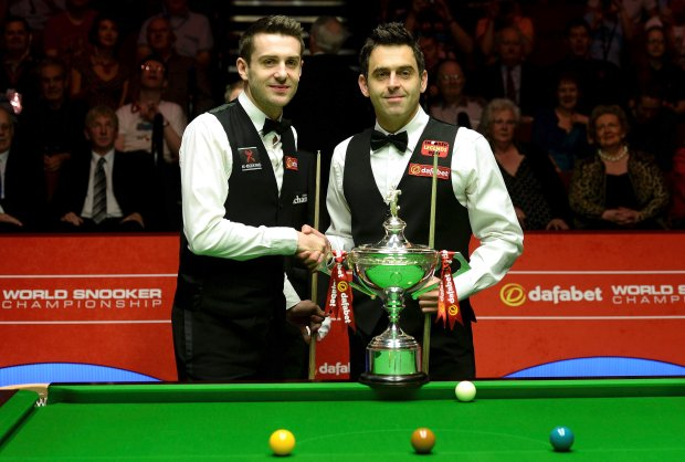 Ronnie O'Sullivan, right, and Mark Selby shake hands, before they start the final of the World Snooker Championships at The Crucible, Sheffield., England, Sunday May 4, 2014. (AP Photo/PA, Martin Rickett)  UNITED KINGDOM OUT  NO SALES  NO ARCHIVE