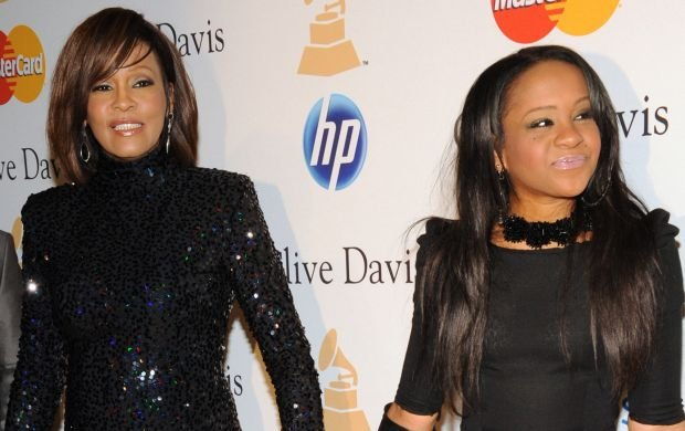 tSinger Whitney Houston (L) and her daughter Bobbi Kristina Brown arrive at the Pre-Grammy Gala & Salute to Industry Icons with Clive Davis honoring David Geffen in Beverly Hills, California on February 12, 2011.  REF NO : 74018 FOR EDITORIAL USE ONLY