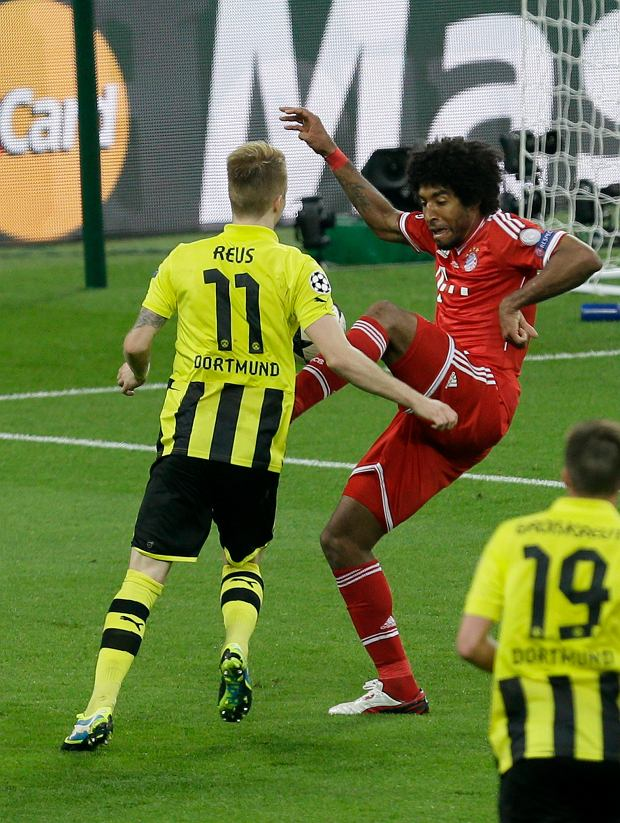 Bayern's Dante of Brazil, right, fouls Dortmund's Marco Reus during the Champions League Final soccer match between  Borussia Dortmund and Bayern Munich at Wembley Stadium in London, Saturday May 25, 2013. (AP Photo/Alastair Grant)