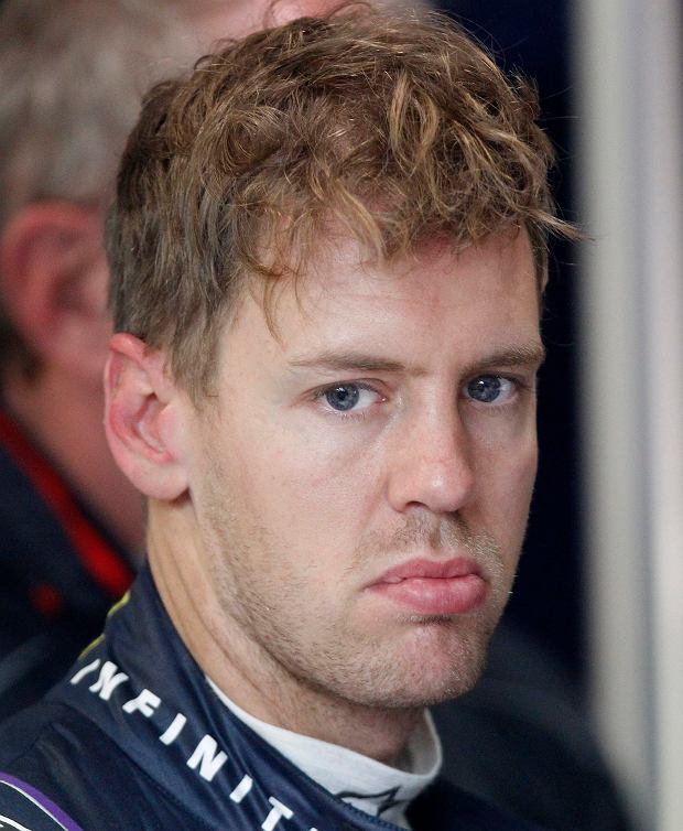 Red Bull Formula One driver Sebastian Vettel of Germany reacts during the qualifying session of the Australian F1 Grand Prix at the Albert Park circuit in Melbourne, Australia, Saturday, March 16, 2013. (AP Photo/Brandon Malone, Pool)