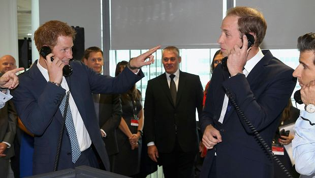 Britain's Prince Harry (L) and Prince William (2nd R) take part in a trade on the trading floor of BGC Partners in London September 11, 2013. The company, formerly part of Cantor Fitzgerald, holds a Charity Day each year to commemorate the 658 employees who lost their lives in the 9/11 attacks on the World Trade Centre in New York.  REUTERS/Chris Jackson/pool (BRITAIN - Tags: ANNIVERSARY BUSINESS ROYALS)