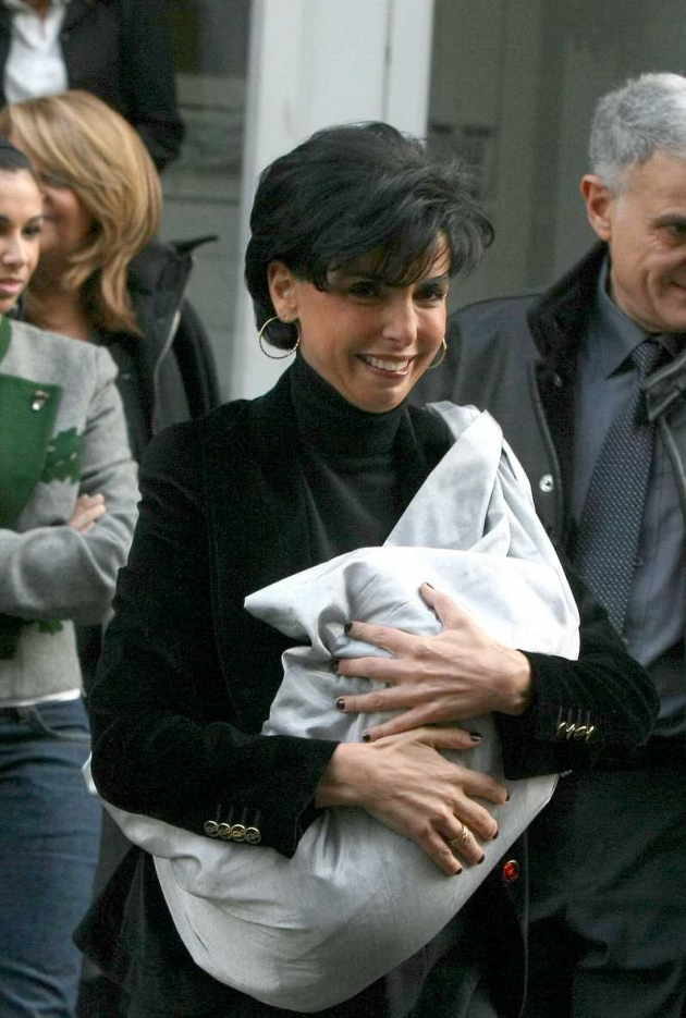 French Justice Minister Rachida Dati (43) surounded by her sisters leaves an exclusive Paris maternity clinic five days after giving birth to a baby girl on Friday January 2, by caesarean section. Zohra, her first child, was born two weeks early and speculation has intensified over the identity of the baby?s father. Ms. Dati, 43 and single, has made a ?personal decision? not to name him. She hopes to be back in work by next week. Paris, FRANCE-07/01/2009