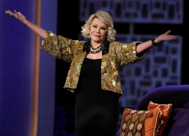 FILE - In this Sunday, July 26, 2009 file photo, Joan Rivers greets the audience at the