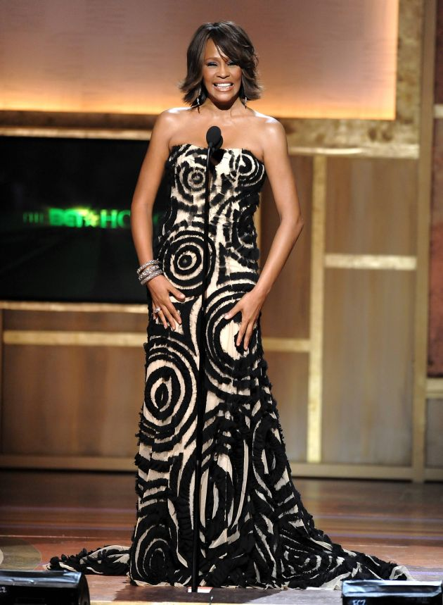 Singer Whitney Houston presents an award at the BET Honors at the Warner Theatre on Saturday, Jan. 17, 2009 in Washington. (AP Photo/Evan Agostini)