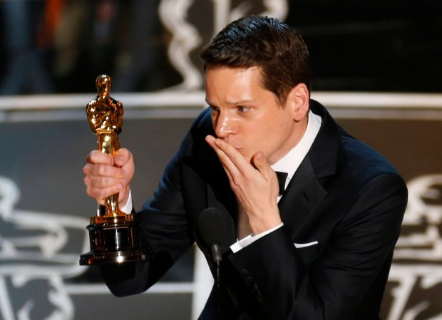 Writer Graham Moore accepts the Oscar for best adapted screenplay for the film