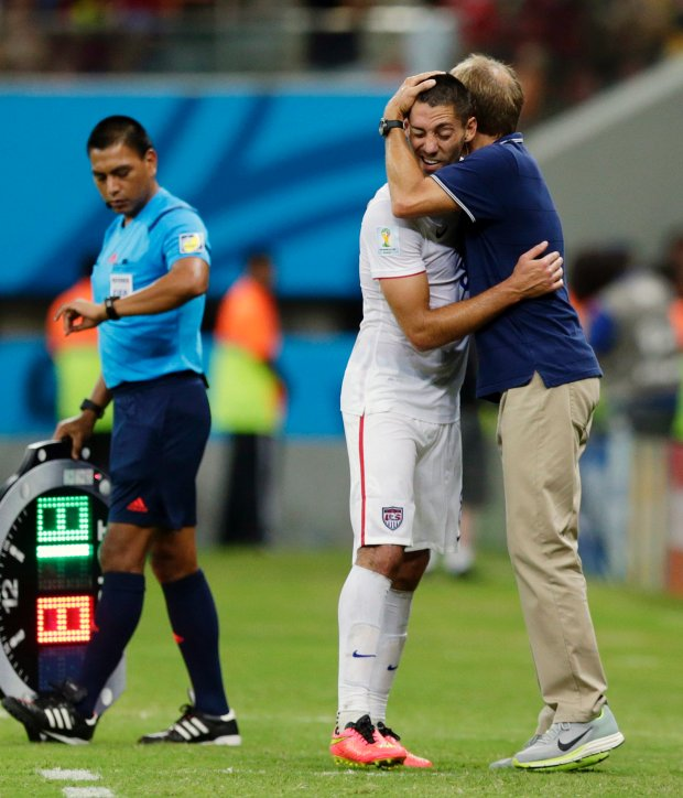 United States' head coach Juergen Klinsmann hugs United States' Clint Dempsey during the group G World Cup soccer match between the United States and Portugal at the Arena da Amazonia in Manaus, Brazil, Sunday, June 22, 2014. The United States and Portugal tied 2-2. (AP Photo/Julio Cortez)