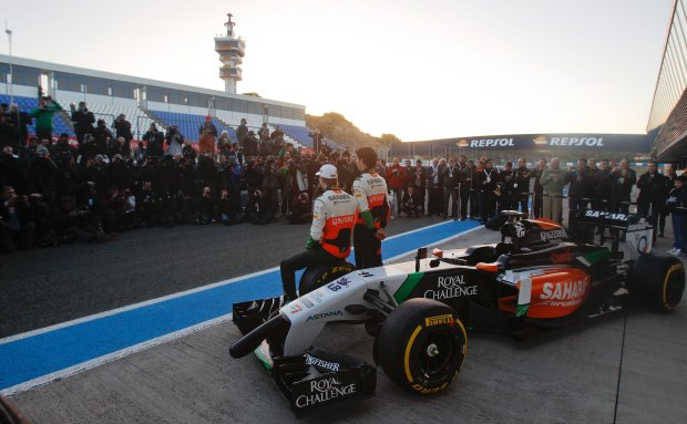 Force India drivers Sergio Perez of Mexico, right, and Nico Hulkenberg of Germany, left, attend the launch of the new VJM07 car at the Circuito de Jerez in Jerez de la Frontera, Spain, Tuesday, Jan. 28, 2014. (AP Photo/Miguel Angel Morenatti)