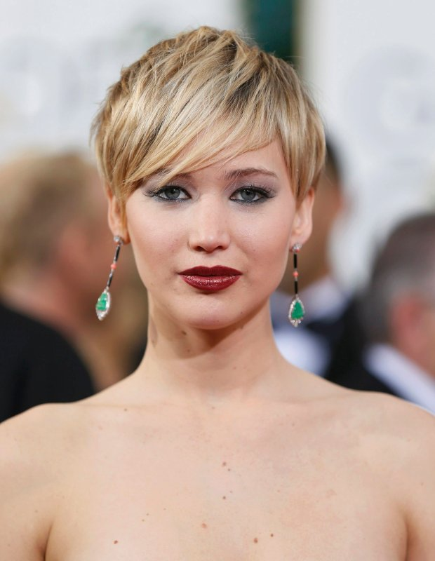 Actress Jennifer Lawrence arrives at the 71st annual Golden Globe Awards in Beverly Hills, California January 12, 2014.  REUTERS/Danny Moloshok  (UNITED STATES - Tags: Entertainment)(GOLDENGLOBES-ARRIVALS)