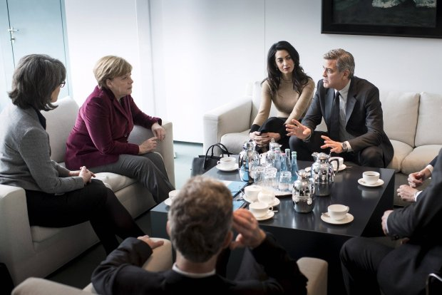 German Chancellor Angela Merkel (2nd L) receives actor George Clooney (R) and his wife Amal (2nd R) in the Chancellery in Berlin, Germany, February 12, 2016, to discuss the policy on refugees and the work of the International Rescue Committee. REUTERS/Bundesregierung/Guido Bergmann/Handout via Reuters    TPX IMAGES OF THE DAY      ATTENTION EDITORS - THIS PICTURE WAS PROVIDED BY A THIRD PARTY. REUTERS IS UNABLE TO INDEPENDENTLY VERIFY THE AUTHENTICITY, CONTENT, LOCATION OR DATE OF THIS IMAGE. EDITORIAL USE ONLY. NOT FOR SALE FOR MARKETING OR ADVERTISING CAMPAIGNS. NO RESALES. NO ARCHIVE. THIS PICTURE IS DISTRIBUTED EXACTLY AS RECEIVED BY REUTERS, AS A SERVICE TO CLIENTS.