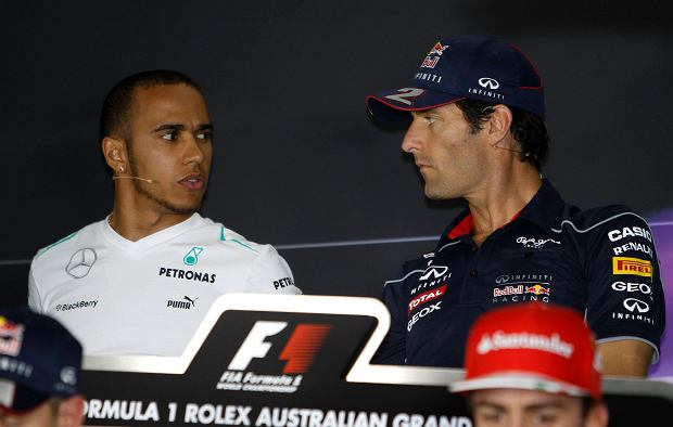 Mercedes Formula One driver Lewis Hamilton of Britain talks to Red Bull Formula One driver Mark Webber of Australia during the official press conference at Albert Park circuit in Melbourne March 14, 2013, ahead of the Australian F1 Grand Prix. REUTERS/Brandon Malone(AUSTRALIA - Tags: SPORT MOTORSPORT)