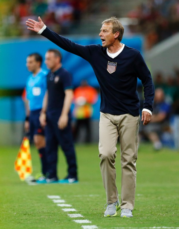 United States' head coach Juergen Klinsmann shouts out instructions to his players during the group G World Cup soccer match between the United States and Portugal at the Arena da Amazonia in Manaus, Brazil, Sunday, June 22, 2014. (AP Photo/Julio Cortez)