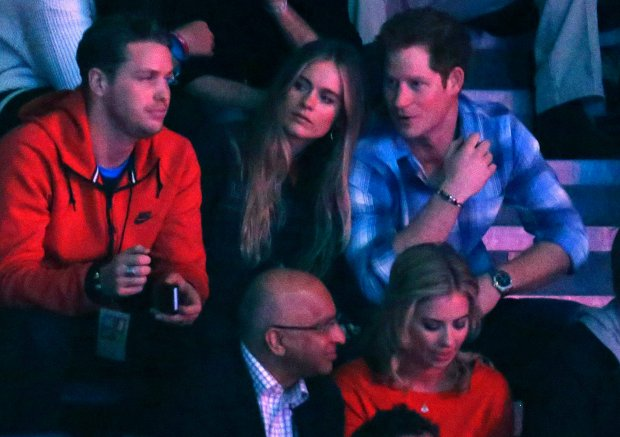 REFILE - ADDING RESTRICTIONS  Britain's Prince Harry (R) and Cressida Bonas (2nd R) watch the WE Day UK event at Wembley Arena in London March 7, 2014.  The inaugural WE Day UK event is run by the charity Free the Children to inspire young people to take action on global issues in a voluntary capacity. REUTERS/Luke MacGregor  (BRITAIN - Tags: ENTERTAINMENT BUSINESS POLITICS EDUCATION SOCIETY ROYALS) FOR EDITORIAL USE ONLY. NOT FOR SALE FOR MARKETING OR ADVERTISING CAMPAIGNS
