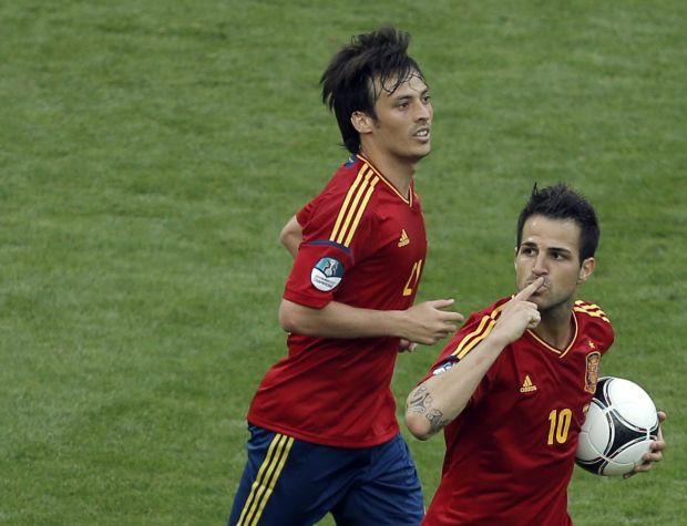 Spain's Cesc Fabregas, front, celebrates scoring his side's first goal during the Euro 2012 soccer championship Group C match between  Spain and Italy in Gdansk, Poland, Sunday, June 10, 2012. (AP Photo/Gero Breloer)