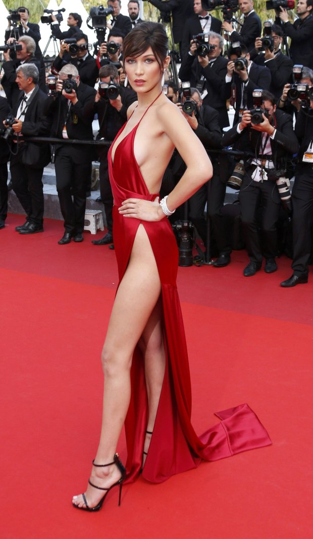 Model Bella Hadid poses on the red carpet as she arrives for the screening of the film La fille inconnue