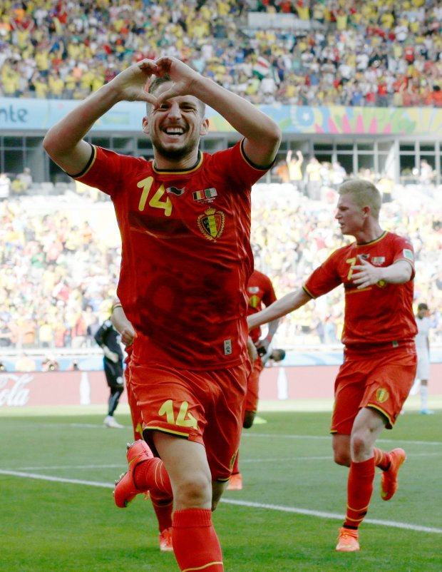 Belgium's Dries Mertens celebrates after scoring his side's second goal during the group H World Cup soccer match between Belgium and Algeria at the Mineirao Stadium in Belo Horizonte, Brazil, Tuesday, June 17, 2014. (AP Photo/Hassan Ammar)