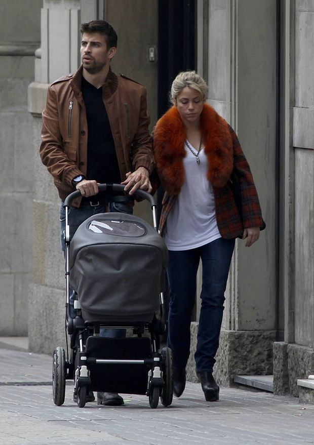 EXCLUSIVE: Singer Shakira and Spanish footballer Gerard Pique walking baby Milan in a baby stroller.  Pictured: Gerard Pique and Shakira