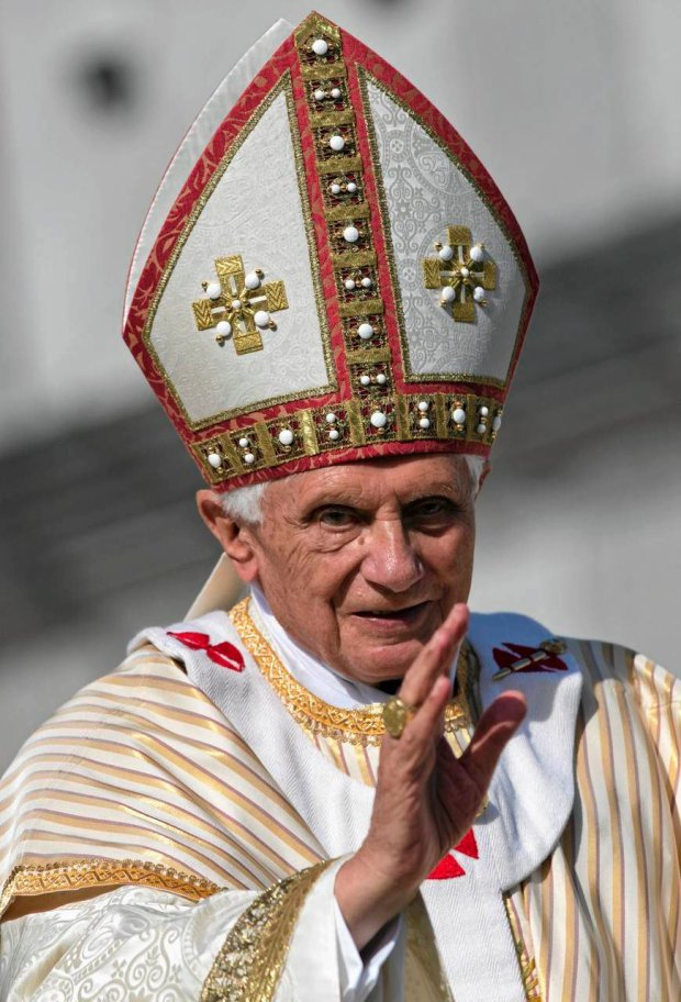 Pope Benedict XVI delivers his blessing as he leaves at the end of a canonization ceremony he celebrated in St. Peter's Square, at the Vatican, Sunday, Oct. 21, 2012. The pontiff canonized seven people, Kateri Tekakwitha, Maria del Carmen, Pedro Calungsod, Jacques Berthieu, Giovanni Battista Piamarta, Mother Marianne Cope, and Anna Shaeffer. (AP Photo/Andrew Medichini)