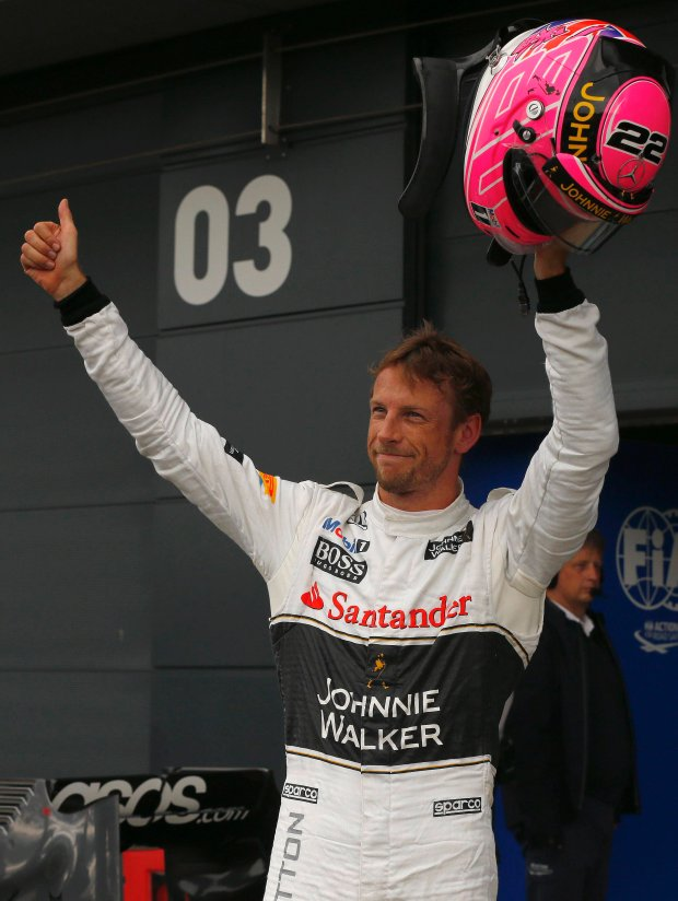 McLaren Formula One driver Jenson Button of Britain gestures after qualifying in third place ahead of the British Grand Prix at the Silverstone Race Circuit, central England, July 5, 2014. REUTERS/Phil Noble (BRITAIN - Tags: SPORT MOTORSPORT F1)