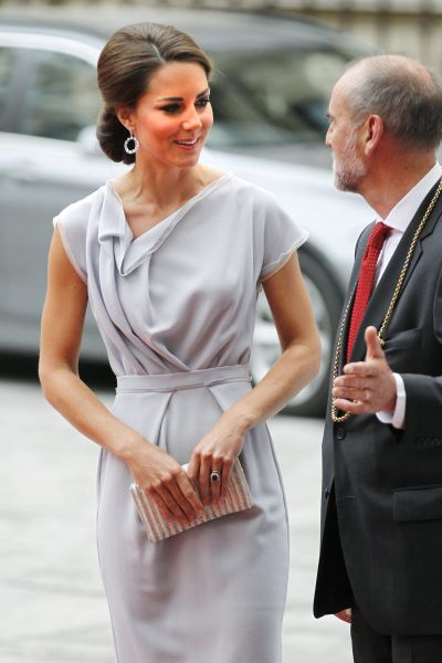 Kate, Duchess of Cambridge is met by the President of the Royal Academy of Arts, Christopher Le Brun as she arrives at the Royal Academy of Arts in London for the UK creative industries reception hosted by the British Government supported by the Founders Forum, Monday, July 30, 2012. (AP Photo/Sang Tan)