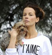 EXCLUSIVE: Kate Beckinsale, who was wearing a baggy jumper which read 'Je t'aime' french for 'I Love You' took her 2 dogs for a walk in the LA rain!. The actress was seen dressed down in jogging pants and a baggy jumper with hair tied up as she went for a walk with her mum around the santa monica trails in california. Beckinsale was seen carrying her small dog into the the park as she braved the colder conditions for Los Angeles.  Pictured: Kate Beckinsale