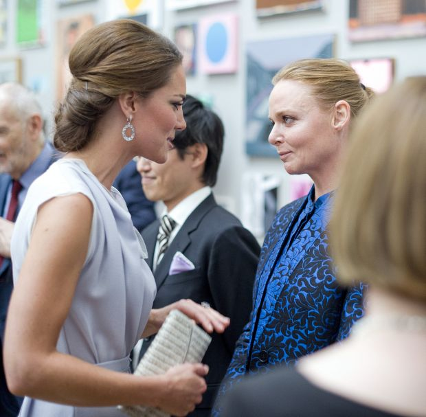 The Duchess of Cambridge talks with Stella McCartney, right,  at the Royal Academy of Arts in London for the UK creative industries reception hosted by the British Government supported by the Founders Forum, Monday, July 30, 2012. (AP Photo/Geoff Pugh)