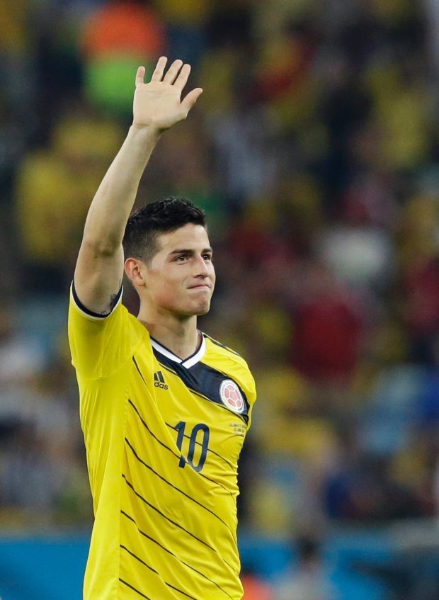 Colombia's James Rodriguez waves to supporters following Colombia's 2-0 victory over Uruguay during the World Cup round of 16 soccer match between Colombia and Uruguay at the Maracana Stadium in Rio de Janeiro, Brazil, Saturday, June 28, 2014.  (AP Photo/Matt Dunham)