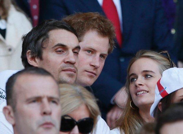 Britain's Prince Harry (C) reacts before England's Six Nations international rugby union match against Wales at Twickenham in London March 9, 2014.    REUTERS/Stefan Wermuth (BRITAIN - Tags: SPORT RUGBY ROYALS)