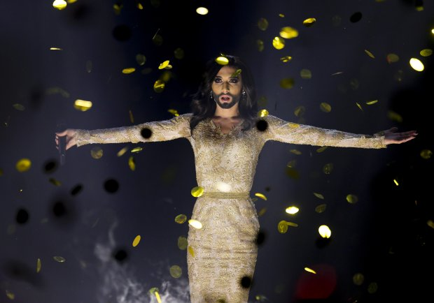 Singer Conchita Wurst representing Austria performs the song 'Rise Like a Phoenix' after winning the Eurovision Song Contest in the B&W Halls in Copenhagen, Denmark, Saturday, May 10, 2014.(AP Photo/Frank Augstein)