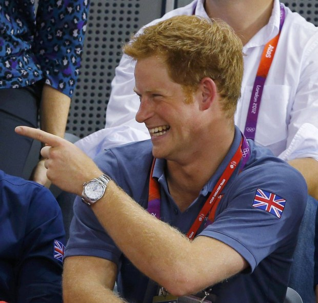 Britain's Prince William (C), his wife Catherine (L), Duchess of Cambridge and Prince Harry watch the track cycling event at the Velodrome during the London 2012 Olympic Games August 2, 2012.  REUTERS/Cathal McNaughton (BRITAIN  - Tags: OLYMPICS SPORT CYCLING ROYALS)