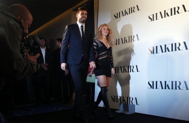 Colombian singer Shakira, right, and FC Barcelona's soccer player Gerard Pique arrive during the presentation of her new album