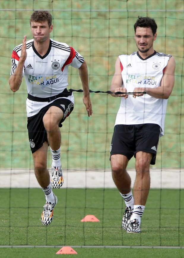 German's national soccer player Thomas Mueller, left, and teammate Mats Hummels practice during a training session near Porto Seguro, Brazil, Monday, June 9, 2014. Germany will play in group G of the 2014 soccer World Cup. (AP Photo/Matthias Schrader)