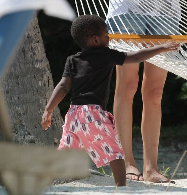 Charlize Theron taking a stroll with her son Jackson on the beach in The Florida Keys. Charlize was taking a pictures of her son on the beach.  Pictured: Charlize Theron and Jackson
