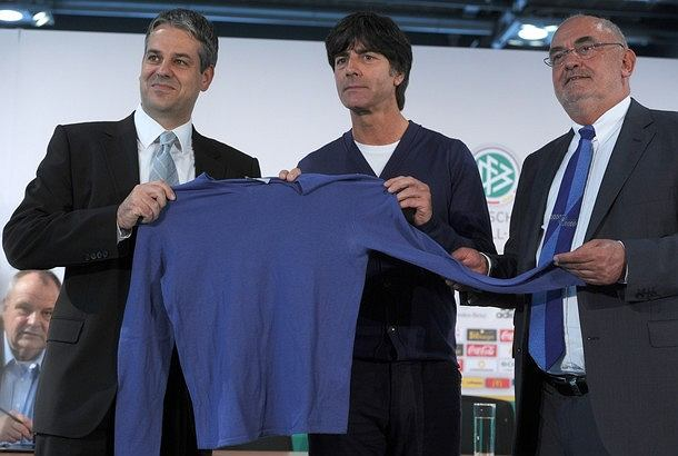 (L-R) Manuel Neukirchner of the German football museum, Germany's head coach Joachim Loew and Lovro Mandac, chairman of GALERIA Kaufhof GmbH retail chain, pose with a blue sweater which Loew wore during the Football World Cup 2010, during a press conference in Duesseldorf, western Germany, on October 10, 2011, one day before the Euro 2012 qualifying football match against Belgium in Duesseldorf, scheduled for October 11, 2011. Galeria Kaufhof bought Loew's talisman, the blue sweater, after the World Cup at an auction for one million euros. The sweater will be on display at the German Football Federation's (DFB) football museum, which is scheduled to open its doors in the year 2014 in Dortmund, western Germany.     AFP PHOTO PATRIK STOLLARZ (Photo credit should read PATRIK STOLLARZ/AFP/Getty Images)