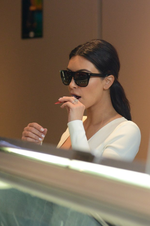 Kim Kardashian and Kanye West have buy icecreams Haagen-Dazs ice in St Honoré street in Paris. After, they are go to see Jean Touitou (designer of A.P.C. French ready-to-wear brand) at street