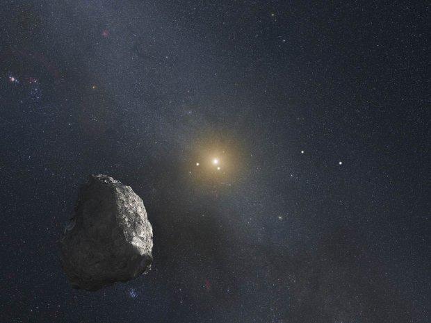 Artystyczna wizja Pasa Kuipera pełnego drobnych odłamków, wśród których znajdują się większe obiekty